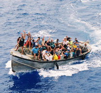 The entire population of Pitcairn Island waves to the M.V. Discovery from their longboat.