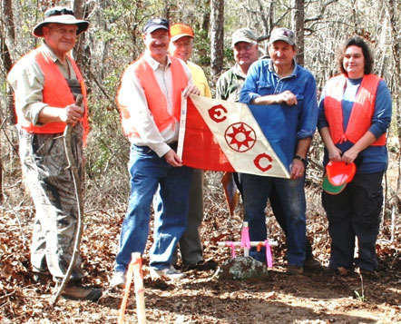 Lew and team of volunteers and archaeologists carry the Explorers Club Flag